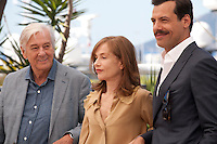 Director Paul Verhoeven, Isabelle Huppert and Laurent Lafitte at the Elle film photo call at the 69th Cannes Film Festival Saturday 21st May 2016, Cannes, France. Photography: Doreen Kennedy