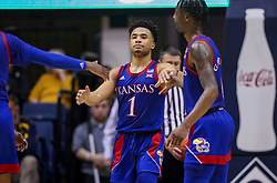 Feb 12, 2020; Morgantown, West Virginia, USA; Kansas Jayhawks guard Devon Dotson (1) celebrates with Kansas Jayhawks guard Marcus Garrett (0) after a play during the second half against the West Virginia Mountaineers at WVU Coliseum. Mandatory Credit: Ben Queen-USA TODAY Sports