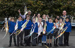 """Over 300 children from primary schools across Edinburgh are taking part in lantern making workshops this October, as part of the activities leading up to Diwali, the annual Festival of Light celebrated by Hindus, Jains and Sikhs throughout the world.<br /> <br /> The workshops, for P6 and 7 pupils, are being led by Leith-based artists, Vision Mechanics. The lanterns will be designed as """"flowers of light"""", and constructed using special waterproof paper to withstand the Scottish weather.<br /> <br /> Pictured: Lord Provost, Frank Ross  and Festival organiser, Mohindra Dhall with pupils from P6 of St Mary's RC Primary School"""