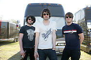 18th April 2009. Indio, California. (L-R) Musicians, Michael Campbell, Liam Fray and Daniel Conan Moores, of The Courteeners pose next to their tour bus, at the Coachella Music Festival..PHOTO © JOHN CHAPPLE / REBEL IMAGES.tel +1 310 570 9100    john@chapple.biz