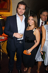 ADRIAN & VASSI HARRIS at a dinner hosted by Stratis & Maria Hatzistefanis at Annabel's, Berkeley Square, London on 24th March 2006 following the christening of their son earlier in the day.<br /><br />NON EXCLUSIVE - WORLD RIGHTS