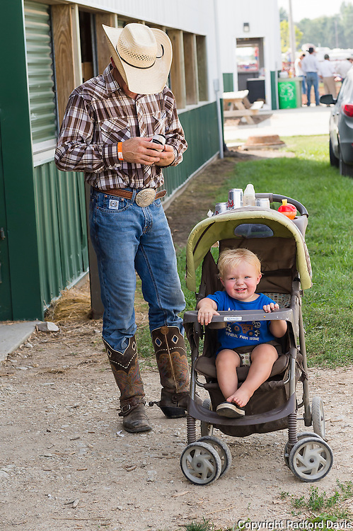 One of the bull riders takes time for his son after his event.
