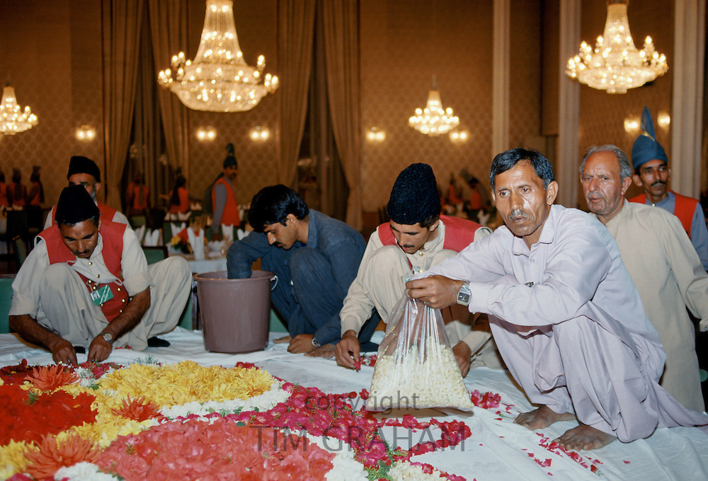 Making floral display of flower petals for celebration in Lahore, Pakistan