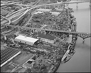 """Ackroyd 13725-2 """"Zidell Explorations Inc. aerial of their plant. January 25, 1966"""" (under west side of Ross Island Bridge)"""