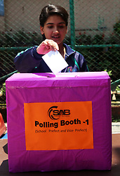 May 5, 2017 - Kathmandu, Nepal - A Nepali student casts vote in a ballot box during an election organized to elect student leaders in a local school prior to country's local election in Kathmandu.This exercise is supposed to increase the awareness and knowledge about the local election being held on May 14 and June 14 in different parts of the country. (Credit Image: © Sunil Sharma via ZUMA Wire)