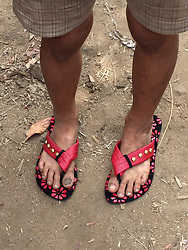 "HEARTBREAKING moment kind man gives poverty stricken children shoes seen for the first time in remote hill tribe... .The intense poverty of the hill tribes in northern Thailand with the wealth and opulence of its capital, Bangkok.. .The latter has numerous shopping malls promoting brands such as Prada, Channel and Rolex and when you are tired of shopping you can retreat to your suite in the many six-star hotels.. .In the far north around Mae Hong Son the picture couldn't be more different. Mae Hong Son is a remote, mountainous province in northern Thailand, bordering Myanmar (Burma). Though sparsely populated, it's ethnically diverse and home to hill tribes such as the Shan and Hmong. . .Somchai Somchai, explains how he and colleagues took shoes and toys to the children of one hill tribe village.. .He said ""for many, these are the first shoes and toys they have ver had – or at least – the first new ones"". .Somchai can be heard trying to talk to the children who, although the same nationality as him, don't understand as their remoteness has resulted in a separate language developing.. .Somchai urges all readers to try to help.  He says ""when people ask for money for causes such as this many potential donors are worried that it is a scam and hold back.  In this case all we are requesting is that people donate the bare essential of life such as shoes, toys and simple medecines etc"".©Somchai Somchai/Exclusivepix Media (Credit Image: © Exclusivepix media via ZUMA Press)"