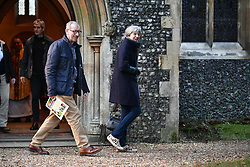 © Licensed to London News Pictures. 07/01/2018. Sonning, UK. British prime minister THERESA MAY attends a morning church service with her husband PHILIP MAY, near her constituency home. Photo credit: Ben Cawthra/LNP