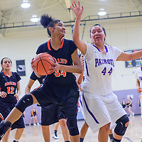 020315       Cable Hoover<br /> <br /> Gallup Bengal Ni'Asia McIntosh (34) holds off Miyamura Patriot Alaiah Nelson (44) Tuesday at Miyamura High School.
