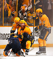 NASHVILLE, TN - MAY 02:  Roman Josi #59, Ryan Ellis #4, and Filip Forsberg #9 of the Nashville Predators congratulate teammate James Neal #18 on scoring a goal against the St. Louis Blues during the third period of Game Four of the Western Conference Second Round during the 2017 NHL Stanley Cup Playoffs at Bridgestone Arena on May 2, 2017 in Nashville, Tennessee.  (Photo by Frederick Breedon/Getty Images)