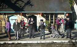 © Licensed to London News Pictures. <br /> 01/10/2016. <br /> Grosmont, UK.  <br /> <br /> Visitors and steam railway enthusiasts wait on the platform as they attend the North Yorkshire Moors Railway Autumn Steam Weekend. <br /> The hugely popular railway line runs a service between Pickering and Whitby through the picturesque North yorkshire countryside and attracts thousands of visitors each year. <br /> <br /> Photo credit: Ian Forsyth/LNP