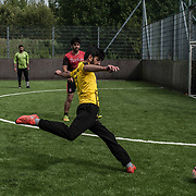 CARRICK-ON-SHANNON, IRELAND - AUGUST 18, 2017: A group of Kurdish men play football in a leisure centre in Carrick-on-Shannon, a small town in the west of Ireland of just five thousand people where a group of Kurdish refugees were resettled from Iraq about 11 years ago. CREDIT: Paulo Nunes dos Santos for The New York Times