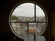 looking out over roof tops in central Amsterdam, west looking from Leidsestraat