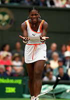 Serena Williams (USA) throws her raquet in the Womens Final. Wimbledon Tennis Championship, Day 12, 5/07/2003. Credit: Colorsport / Matthew Impey