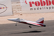 Israel, Massada Air Strip, the international radio controlled model aircraft competition June 27 2009. Jet model plane at takeoff