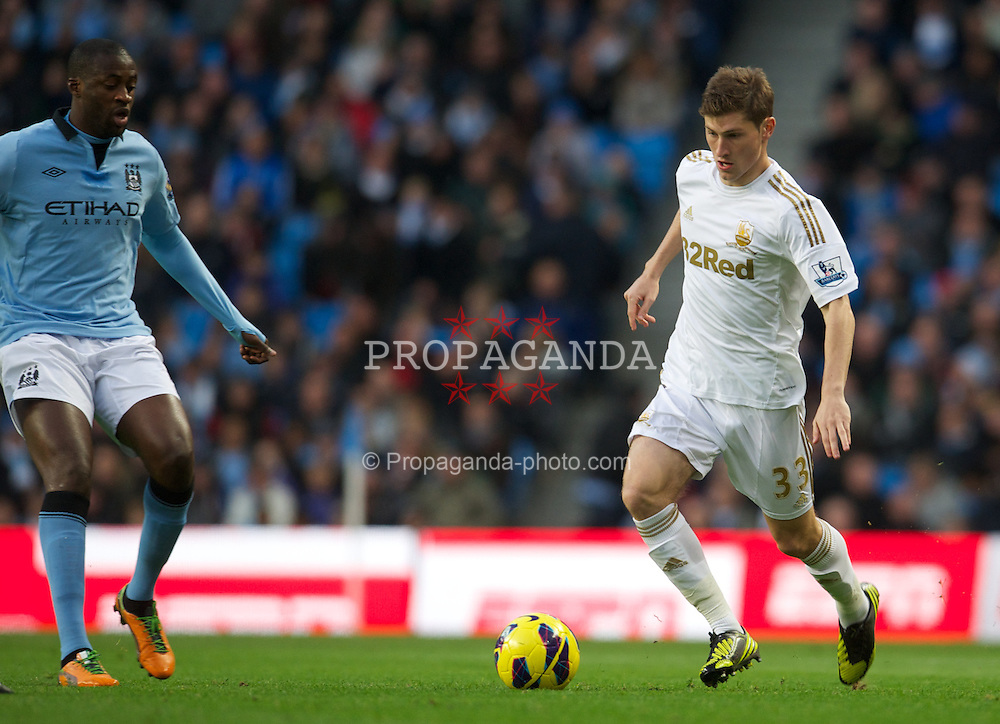 MANCHESTER, ENGLAND - Saturday, October 27, 2012: Swansea City's Ben Davies in action against Manchester City during the Premiership match at the City of Manchester Stadium. (Pic by David Rawcliffe/Propaganda)