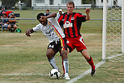 Maurie Wasi of Waikato and Daniel Burns of Canterbury. NZFC Championship Soccer - Waikato v Canterbury, Centennial Park, Ngaruawahia. Sunday, 24 January 2010. Photo: Geoffrey Dickinson/PHOTOSPORT
