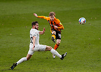 Hull City's Keane Lewis-Potter shoots for goal despite the attentions of Oxford United's Jamie Hanson but it goes just over the bar<br /> <br /> Photographer Lee Parker/CameraSport<br /> <br /> The EFL Sky Bet League One - Hull City v Oxford United - Saturday 13th March 2021 - KCOM Stadium - Kingston upon Hull<br /> <br /> World Copyright © 2021 CameraSport. All rights reserved. 43 Linden Ave. Countesthorpe. Leicester. England. LE8 5PG - Tel: +44 (0) 116 277 4147 - admin@camerasport.com - www.camerasport.com