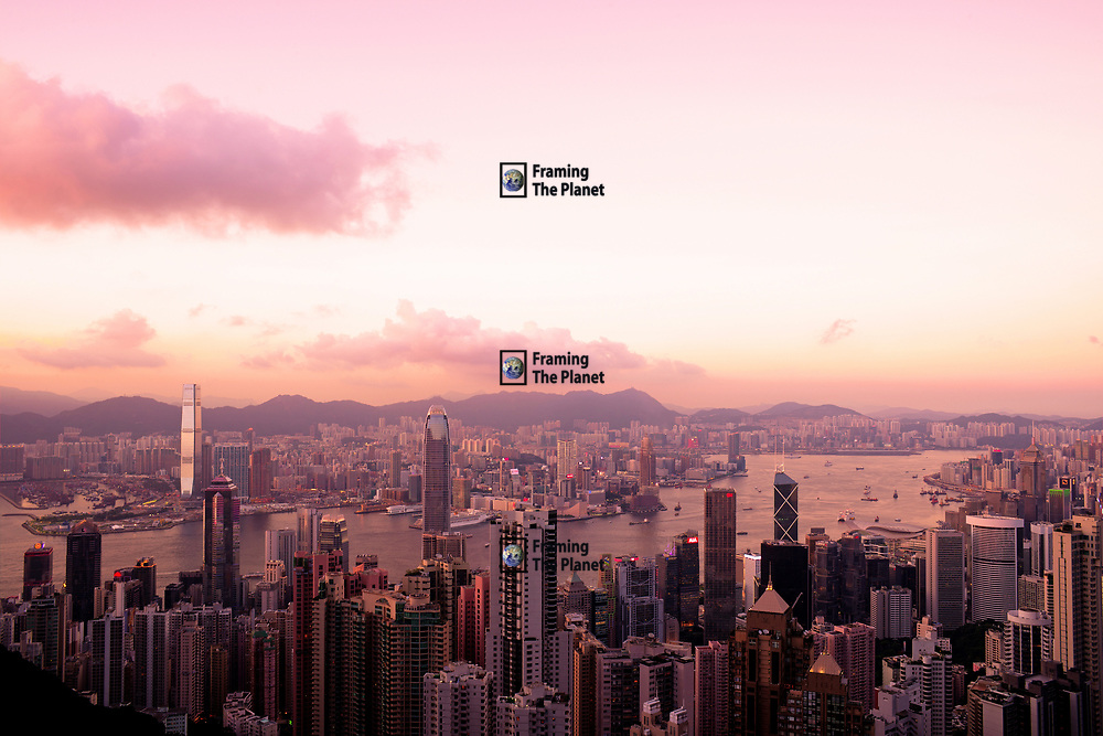 Hong Kong captured here just as the sunsets over this modern city! It is said there are more skyscrapers in Hong Kong than New York and this photo certainly supports that. The city seems to go on forever drifting away into the setting sun. The incredible light at this time of day has given us a beautiful display of pinks and purples making this city seem some what other worldly. The city of the future right here for us to see.<br /> Available to download for personal and commercial use or to purchase as a canvas print, photo print and framed photo print.