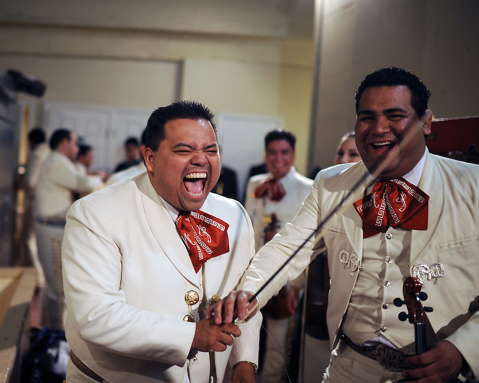 Mariachi Imperial de Mexico members Daniel Gonzales, left, and Misael Torbio laugh back stage before a grand finale with other bands during the 2012 Mariachi Festival at the Fox Theatre in Salinas, California.