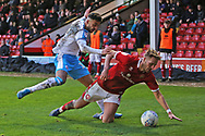 Tarryn Allarakhia brings down Cameron Norman during the EFL Sky Bet League 2 match between Walsall and Crawley Town at the Banks's Stadium, Walsall, England on 18 January 2020.
