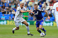 Joe Ralls of Cardiff city (8) goes past Darren Pratley of Bolton.Skybet football league championship match, Cardiff city v Bolton Wanderers at the Cardiff city Stadium in Cardiff, South Wales on Saturday 23rd April 2016.<br /> pic by Andrew Orchard, Andrew Orchard sports photography.
