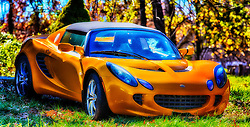 The Lotus Elise is a two seat, rear-wheel drive, mid-engined roadster conceived in early 1994 and released in September 1996 by the English manufacturer Lotus Cars. The car has a hand-finished fibreglass body shell atop its bonded extruded aluminium chassis that provides a rigid platform for the suspension, while keeping weight and production costs to a minimum. The roadster is capable of speeds up to 240 km/h