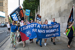 NHS workers from the grassroots NHSPay15 campaign march from Parliament to 10 Downing Street to present Matthew Tovey's petition signed by over 800,000 people calling for a 15% pay rise for NHS workers on 20th July 2021 in London, United Kingdom. At the time of presentation of the petition, the government was believed to be preparing to offer NHS workers a 3% pay rise in 'recognition of the unique impact of the pandemic on the NHS'.