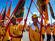 """02 JUNE 2017 - SAMUT SAKHON, THAILAND: The parade for the City Pillar Shrine in Samut Sakhon. The Chaopho Lak Mueang Procession (City Pillar Shrine Procession) is a religious festival that takes place in June in front of city hall in Samut Sakhon. The """"Chaopho Lak Mueang"""" is  placed on a fishing boat and taken across the Tha Chin River from Talat Maha Chai to Tha Chalom in the area of Wat Suwannaram and then paraded through the community before returning to the temple in Samut Sakhon. Samut Sakhon is always known by its historic name of Mahachai.      PHOTO BY JACK KURTZ"""