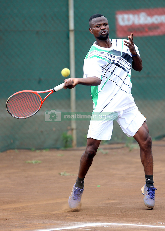Dennis Indondo from Democratic Republic of Congo returns a serve to Petty Andanda of Kenya during their 14th African Nationas Cup (CAN) 2016 at Nairobi Club on November 8, 2016. Dennis won 6-4,6-1. Photo/Fredrick Onyango/www.pic-centre.com (KEN)