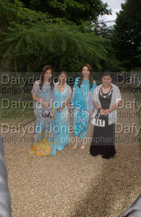 members of Brunei Royal family. Some Enchanted evening, in aid of the Galapagos conservation society.  Chelsea Physic Garden, 17 June 2004. ONE TIME USE ONLY - DO NOT ARCHIVE  © Copyright Photograph by Dafydd Jones 66 Stockwell Park Rd. London SW9 0DA Tel 020 7733 0108 www.dafjones.com