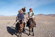 Rupert Sagar-Musgrave with an eagle hunter on horseback at the Eagle Hunting festival near Sagsai, Bayan-Ölgii, Mongolia