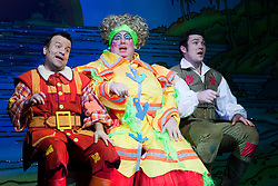 """© Licensed to London News Pictures. 08/12/2011. London, England. L-R: Kev Orkian as Idle Jack, Eric Potts as Sarah the Cook and Sam Attwater as Dick Whittington. Dick Whittington panto starring Dame Edna Everage (Barry Humphries) as the """"Saviour of London"""" opens at the New Wimbledon Theatre, London. The show, written and directed by Eric Potts is scheduled to run to 15 January 2012. Photo credit: Bettina Strenske/LNP"""