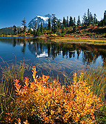Mount Shuksan (9127 feet elevation) is in North Cascades National Park, Washington, USA. Picture Lake is in Heather Meadows, Mount Baker - Snoqualmie National Forest. Stitched from 4 overlapping images.
