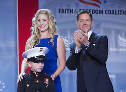 June 8, 2017 - Washington, District of Columbia, United States of America - Gold Star Mother Brittany Jacobs, her son Christian Jacobs and Ralph Reed, founder and chairman of the Faith & Freedom Coalition stand before the Faith and Freedom Coalitionís Road to Majority Conference in Washington, DC, June 8, 2017. .Credit: Chris Kleponis / Pool via CNP (Credit Image: © Chris Kleponis/CNP via ZUMA Wire)