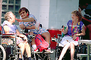 Physically handicapped women ages 45 and 60 eating at Minnesota State Fair.  St Paul  Minnesota USA