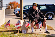 06 NOVEMBER 2020 - DES MOINES, IOWA: DOUG, a US Marine Corps veteran of Operation Desert Storm, asks for help along the side of a freeway entrance in Des Moines. Doug, who can't work because he is on 100 percent disability, said his Veterans' Administration benefits covered his rent and most of his car payment but it didn't leave enough for car insurance or food so he asks for help along the freeway entrance. He said he visits two or three emergency pantries per week to get enough food to get by. Food insecurity in the Des Moines area has skyrocketed since the start of the Coronavirus pandemic. Although unemployment rates in Iowa have fallen since a peak in June, many families that fell behind on rent are now facing eviction. A food bank spokesperson said use of the Food Bank's emergency pantries and distribution points is still increasing.    PHOTO BY JACK KURTZ