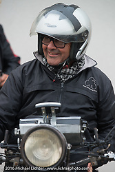 Giuseppe Savoretti of Italy after riding his 1931 Moto Guzzi through the finish during Stage 7 of the Motorcycle Cannonball Cross-Country Endurance Run, which on this day ran from Sedalia, MO to Junction City, KS., USA. Thursday, September 11, 2014.  Photography ©2014 Michael Lichter.