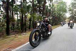 Willie Nieves of Deland, FL riding a 1976 Harley-Davidson Shovelhead customized by Bill Dodge's Blings Cycles through Tamoka State Park during Daytona Beach Bike Week 2015. FL, USA. March 13, 2015.  Photography ©2015 Michael Lichter.