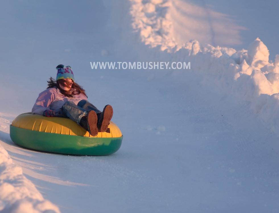 .Hamptonburgh, NY - People slide down the snow tubing hill at Thomas Bull Memorial Park on Feb. 16, 2008.