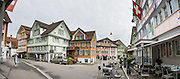 Frescoes decorate buildings in Appenzell village, in Switzerland, Europe. Appenzell Innerrhoden is Switzerland's most traditional and smallest-population canton (second smallest by area). This image was stitched from multiple overlapping photos.