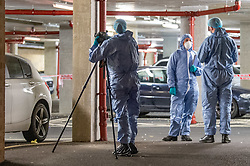 © Licensed to London News Pictures. 12/03/2020. London, UK. A forensic investigator gathers evidence after police were called to reports of a group of youths fighting at Mansion Court in Walthamstow, four teenagers were taken to hospital with stab and slash injuries. Seven arrests were made. Photo credit: Peter Manning/LNP