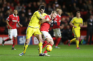 Nelson Oliveira of Nottingham Forest pulls back Chris Solly of Charlton Athletic. Skybet football league championship match, Charlton Athletic v Nottingham Forest at The Valley  in London on Saturday 2nd January 2016.<br /> pic by John Patrick Fletcher, Andrew Orchard sports photography.