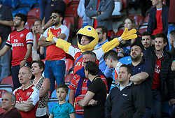 Arsenal fans celebrate in the stands after the Premier League match at the John Smith's Stadium, Huddersfield.