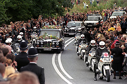 The hearse carring the coffin of Diana, Princess of Wales, arrives at the gates of Althorp House this afternoon (Saturday).