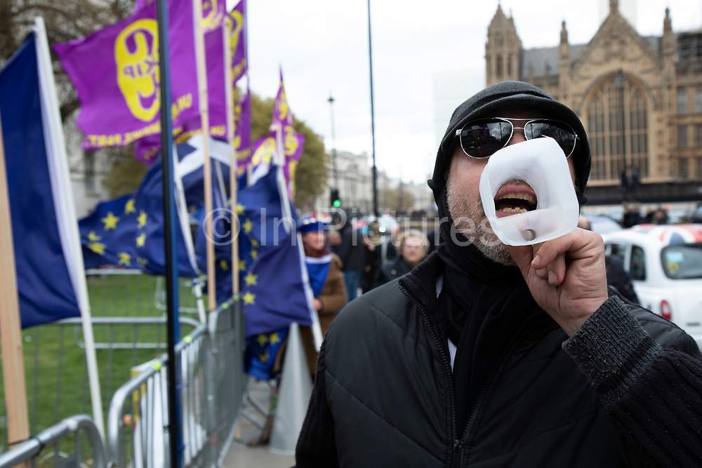 Anti Brexit, protester using a milk carton as a loud hailer in Westminster as the leader of the opposition and the Prime Minister continue talks to solve the Brexit Withdrawal Agreement on 4th April 2019 in London, England, United Kingdom. With just over two weeks until the UK is supposed to be leaving the European Union, the final result still hangs in the balance.