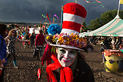 A member of Ambling Arts, a theatre group, offering free hugs in the Green Futures Field, Glastonbury Festival 2016.<br /> The Glastonbury Festival is the largest greenfield festival in the world, and is now attended by around 175,000 people. Its a five-day music festival that takes place near Pilton, Somerset. In addition to contemporary music, the festival hosts dance, comedy, theatre, circus, cabaret, and other arts. Held at Worthy Farm in Pilton, leading pop and rock artists have headlined, alongside thousands of others appearing on smaller stages and performance areas.