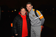 A Middlesbrough fan has his picture taken with Scot Bennett (17) of Newport County before the The FA Cup match between Newport County and Middlesbrough at Rodney Parade, Newport, Wales on 5 February 2019.