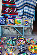 Colorful pottery and blankets for sale in downtown Loreto Mexico