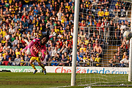 Goal, Josh Ruffels of Oxford United scores as Yves Makabu Ma-Kalambay of Wycombe Wanderers watches the ball go in during the EFL Sky Bet League 1 match between Oxford United and Wycombe Wanderers at the Kassam Stadium, Oxford, England on 30 March 2019.