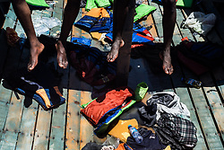 MEDITERRANEAN SEA, LIBYA - JUNE 15 :  Refugees wait to get on onboard the rescue vessel Golfo Azzurro, from a wooden boat sailing out of control in the Mediterranean Sea near Libya on Thursday, June 15, 2017. A Spanish aid organization Thursday rescued 420 migrants who were attempting the perilous crossing of the Mediterranean Sea to Europe in packed boats from Libya. Marcus Drinkwater / Anadolu Agency  | BRAA20170615_363 Mediterranean Sea Libye Libya